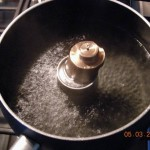 Fixture in boiling water - metal melts at 180 F