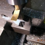 Brass shim gives clearance to face of cutter