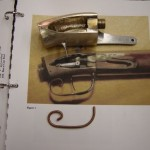 Bronze prototype casting with photo of original gun